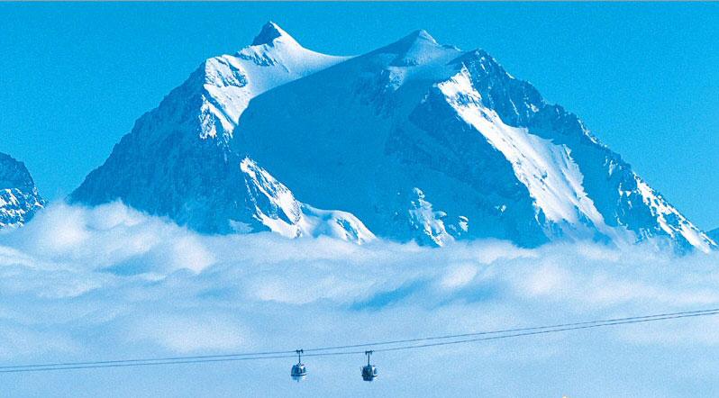 ski lift bubbles above clouds